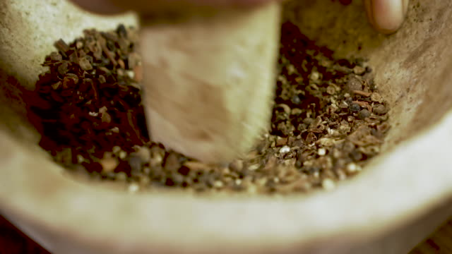Extreme close up of a chef grinding dried spices with a mortar and pestle Extreme close up of a chef grinding dried spices with a mortar and pestle in slow motion mortar and pestle stock videos & royalty-free footage