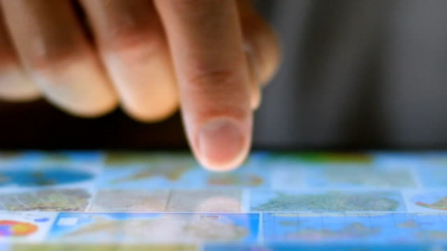 Extreme close up of a finger navigating a digital tablet selecting a map Extreme close up of a finger navigating a digital tablet selecting a map or app pinching stock videos & royalty-free footage