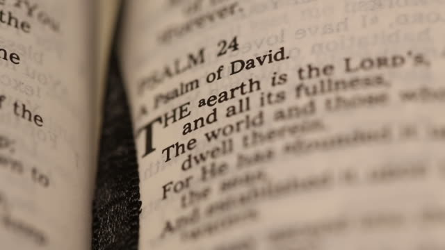 Extreme Close Up Of Bible Verse Psalm 24 With Shallow Focus