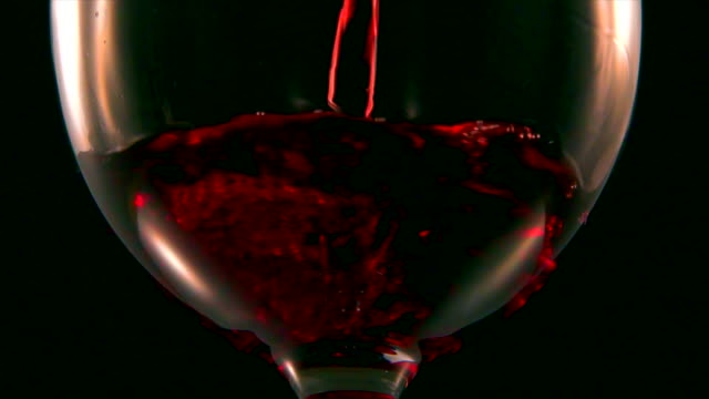 Extreme close up of red wine into glass Slow motion 4k red wine stock videos & royalty-free footage