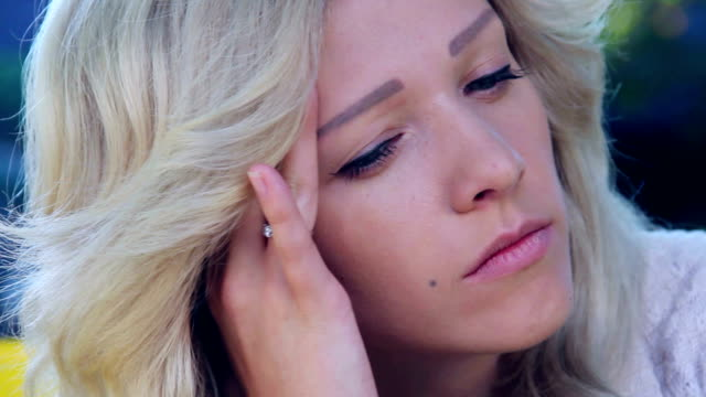 Extreme close up of sad depressed young beautiful woman video