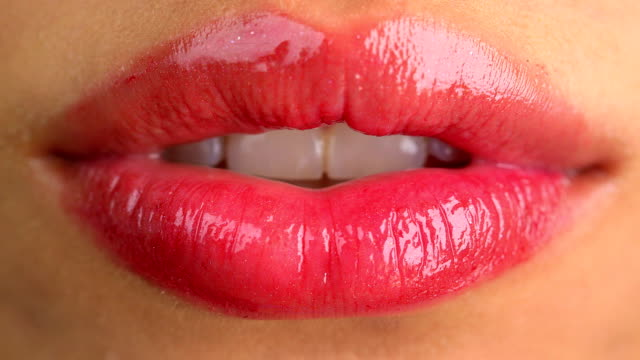 Extreme close up of sexy lips close-up, head and shoulders, front view, looking at camera,  human lips stock videos & royalty-free footage
