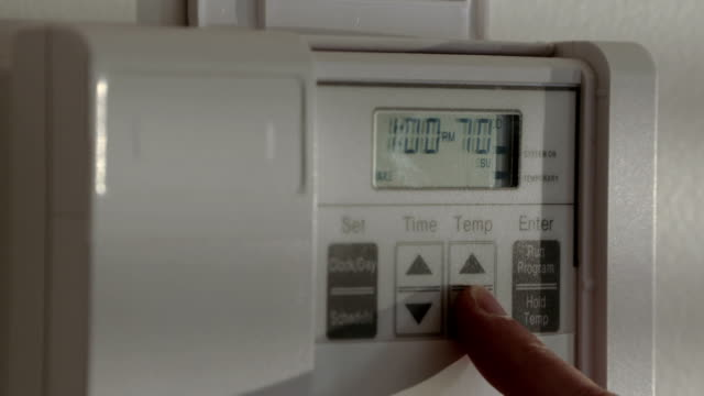 Extreme close up on setting a thermostat to 72 degrees video