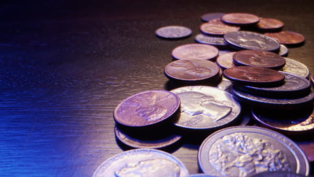 Extreme Close-Up Macro Moving Slider Shot of American Currency Coins