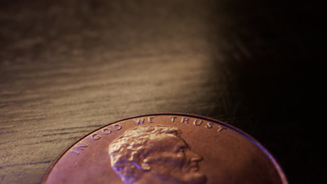 Extreme Close-Up Macro Moving Slider Shot of the Top Heads Side of an American Currency Penny Worth One Cent Shiny, Metallic, Rare Head of American Currency During a United States Treasury Coin Shortage coin stock videos & royalty-free footage