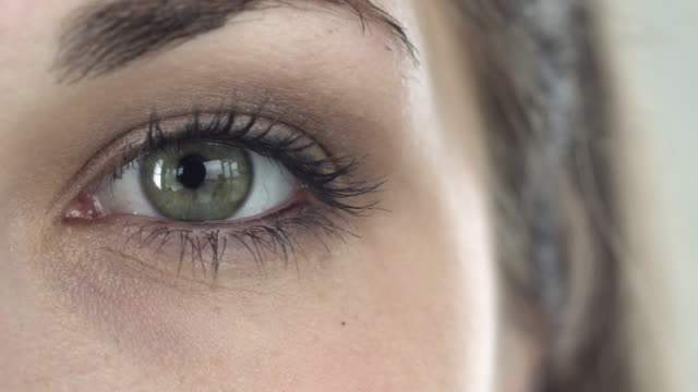 Extreme close-up of a green eye of a girl video