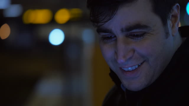 Extreme Closeup of a Man Looking Downwards and  Smiling video