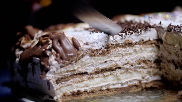 Pleasing Extreme Closeup Of A Womans Hand Slicing A Birthday Cake Funny Birthday Cards Online Kookostrdamsfinfo
