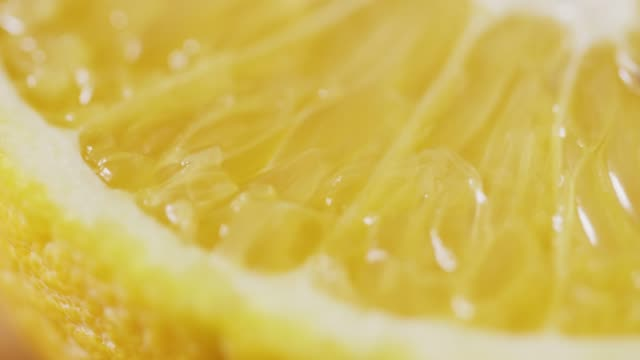 Extreme Closeup Of Fresh Sliced Orange Rotating video