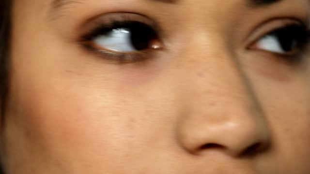 Extreme close-up of happy woman with brown eyes Extreme close-up of happy woman with brown eyes. Portrait of beautiful young female. extreme close up stock videos & royalty-free footage
