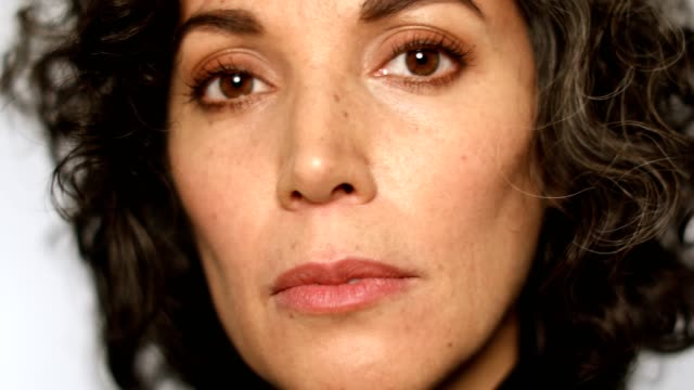 Extreme close-up of mature woman with brown eyes