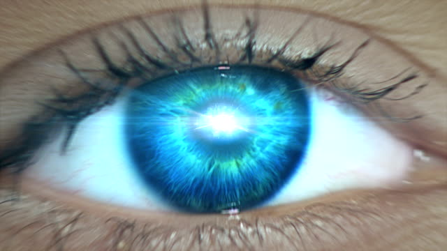 Extreme closeup on blue eye. Entering human mind