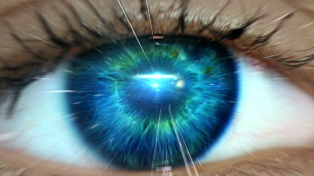 extreme closeup on blue eye. entering human mind - vicino video stock e b–roll