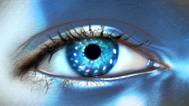 Extreme closeup on blue eye of android. Entering artificial intelligence