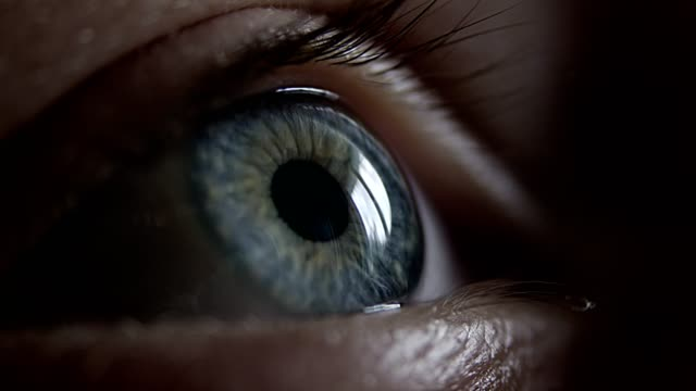 extreme closeup on blue human eye - vicino video stock e b–roll