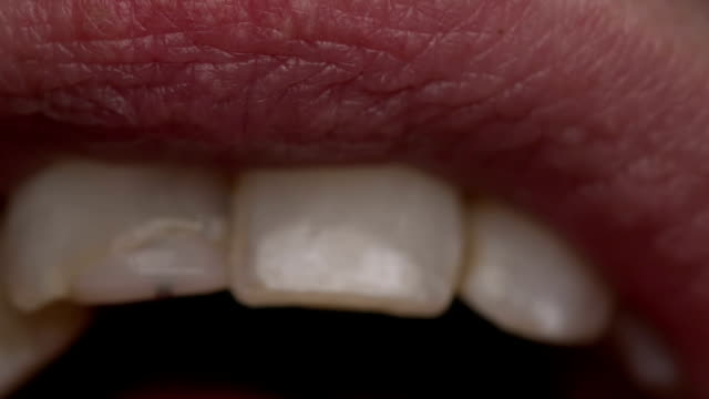 extreme closeup shot of a mouth talking - lingua bocca video stock e b–roll