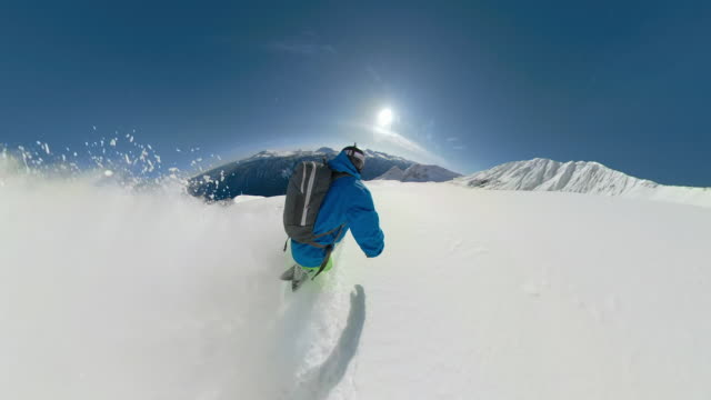 follow: extreme freeride snowboarder shredding pristine snow in remote terrain. - snowboarding video stock e b–roll