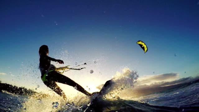Extreme Kitesurfing Girl at Sunset. Summer Ocean Sport in Slow Motion.