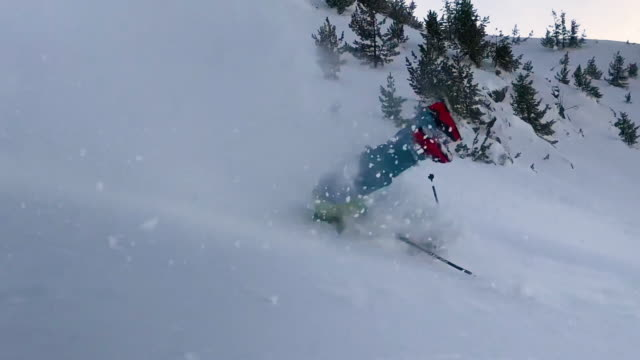 extreme male skier riding off piste jumps and crashes into the fresh powder snow - sci video stock e b–roll