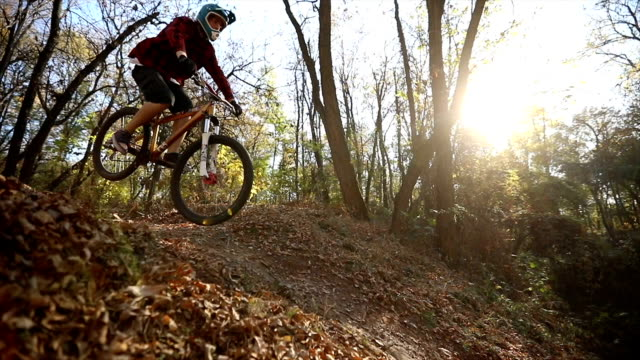Extreme mountain bikers riding over rough terrain video