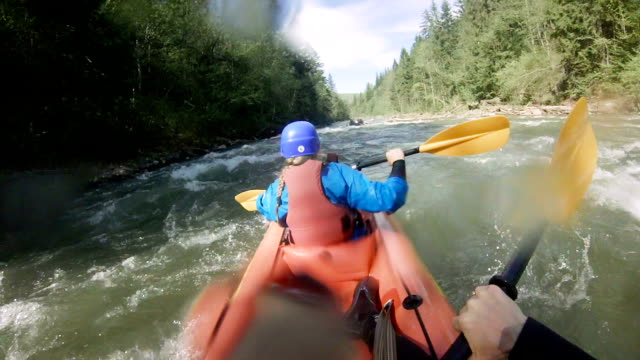 extreme rafting in small boats on mountain river - adrenalina video stock e b–roll