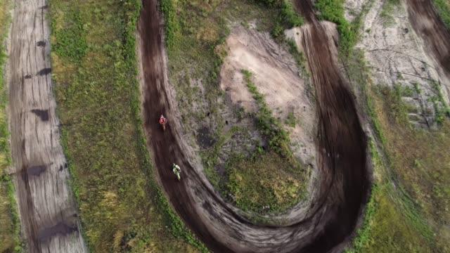 extreme sport motocross racer driving fast terrain