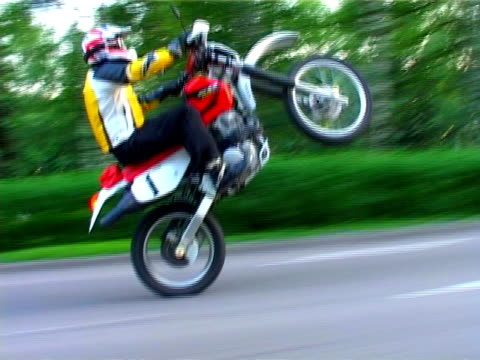 Extreme sport. Motorbike race on the back wheel video