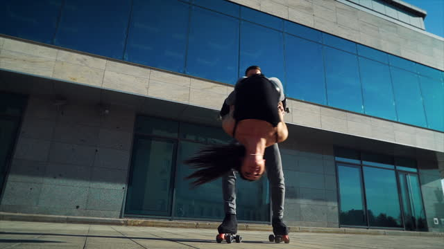 Extreme stunts performed by roller skaters in city video