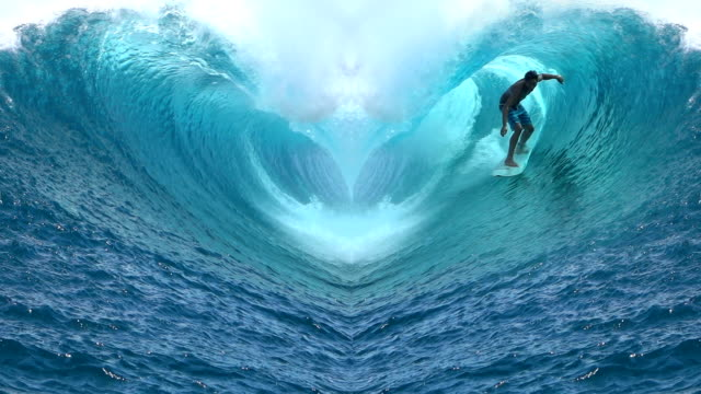 SLOW MOTION: Extreme surfer riding big barrel Teahupoo wave shaped like a heart video