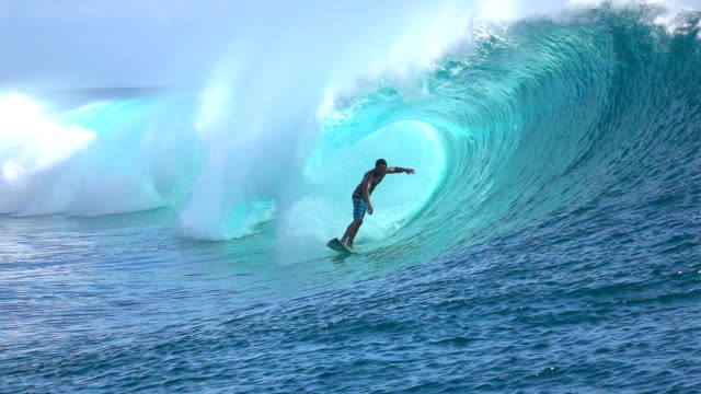 SLOW MOTION: Extreme surfer surfing inside big tube barrel wave video