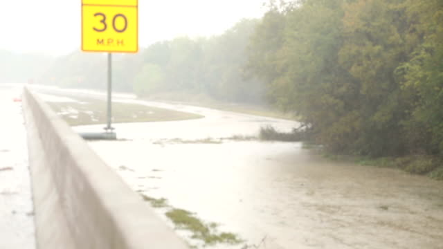 extreme weather. exit closed on highway due to flooding. - gulf coast states stock videos & royalty-free footage