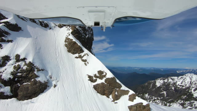Extreme Winter Mountain View Flying Helicopter Close to Mountain Snowy Rocks - Thrilling Flyover Above Peak in Cascades