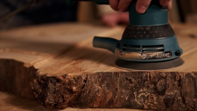 extremely close shooting of manual grinding process in carpenter's hand. wood dust - levigatrice video stock e b–roll