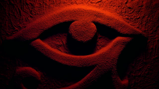 eye of ra wall carving in firelight - египет стоковые видео и кадры b-roll
