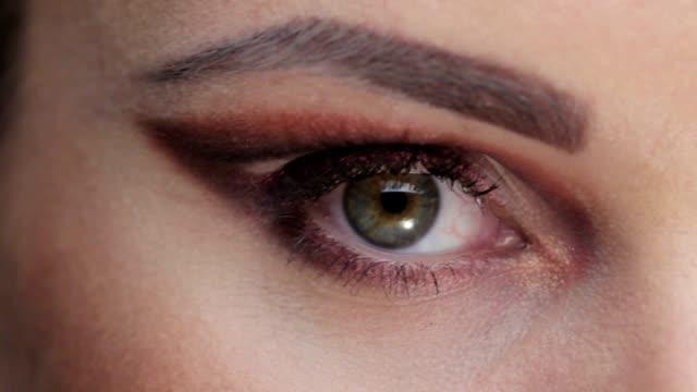 Eye opening Close-up to eye. eyeshadow stock videos & royalty-free footage