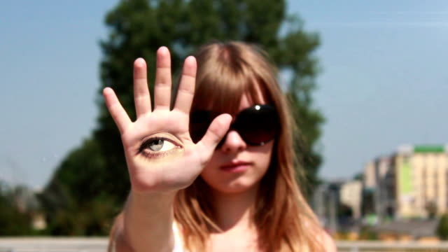 Eye placed on the girl's hand HD video