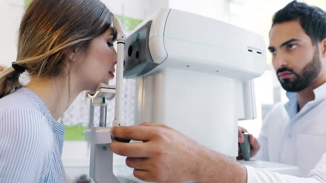 Eye Test. Optometrist Testing Woman Eyesight On Modern Equipment Eye Test. Optometrist Testing Woman Eyesight On Modern Equipment, Optometry Eye Exam ophthalmologist stock videos & royalty-free footage