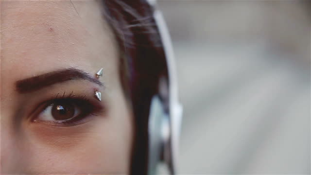 Eyebrow piercing,close up video