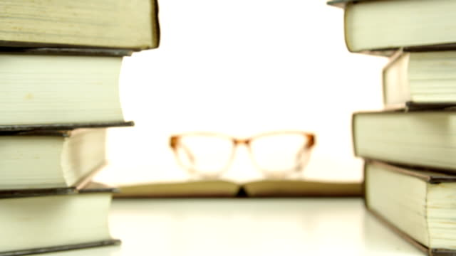 Eyeglasses on the book video