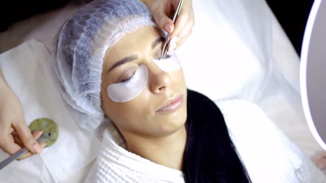 Eyelash extension in beauty shop video
