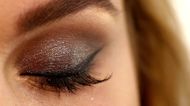 Eyelashes. Cosmetic Eyeshadow. close up, Slow motion Eye makeup woman applying eyeshadow powder. Beautiful woman face. Perfect makeup. Beauty fashion. Eyelashes. Cosmetic Eyeshadow. close up, Slow motion eyeliner stock videos & royalty-free footage