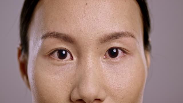 Eyes of a young Asian woman video