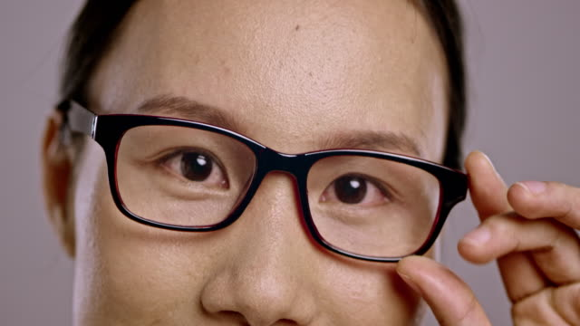 Eyes of a young Asian woman wearing glasses video