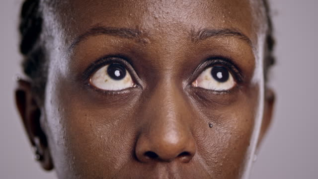 Eyes of an African-American woman looking around video