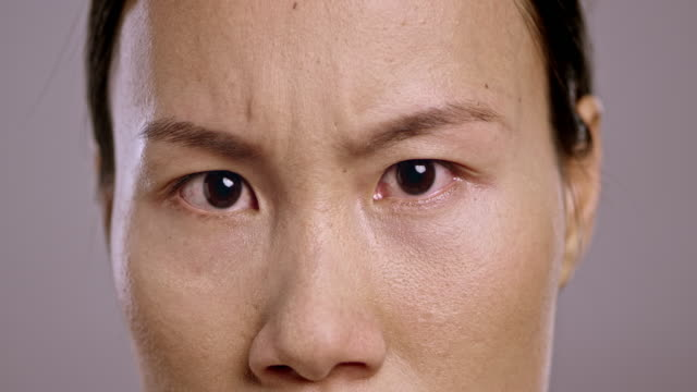 Eyes of an angry young Asian woman video