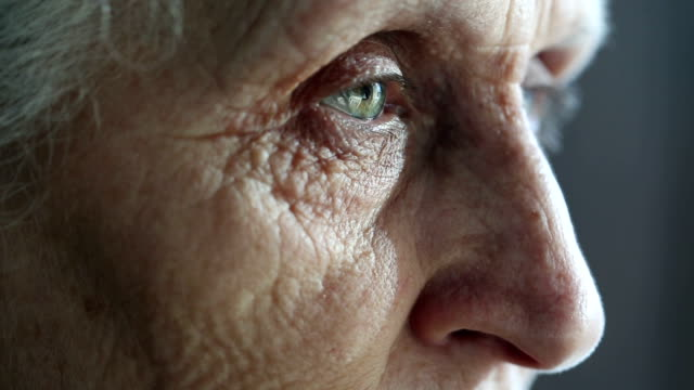 Eyes of an old woman looking away in concentration
