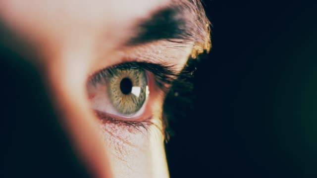 Eyes on the prize Closeup 4K video footage of a man opening his eyes against a dark background eye stock videos & royalty-free footage