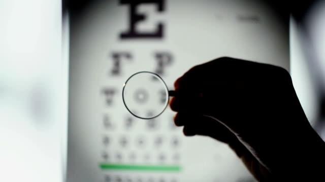 Eyesight examination, optometrist choosing lenses for glasses