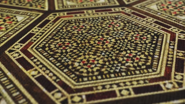 Fabric cloth with Traditional Islamic, Asian pattern macro close up shot with pan movement. Ottoman's design, vintage Oriental tablecloth.
