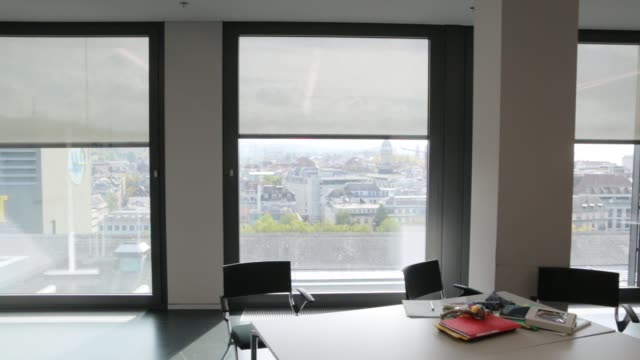 Fabric Roller Blinds Automatic System The fabric roller blinds automatic system window control natural light sun tracking wood texture stock videos & royalty-free footage